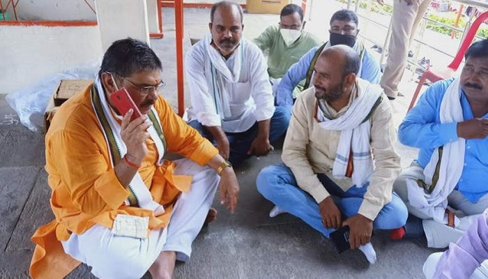 BJP MLA Surendra Singh sitting with supporters
